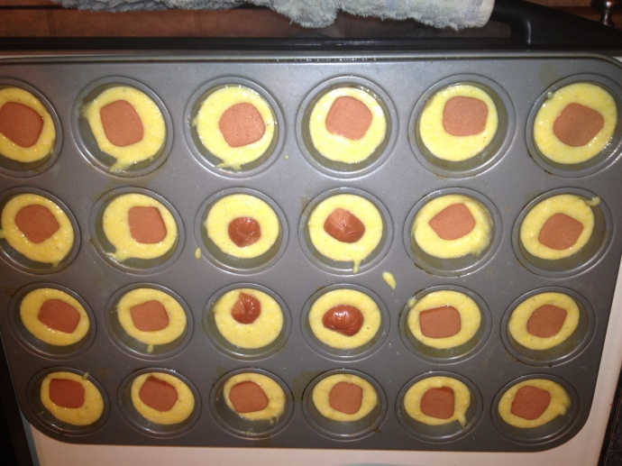 Put the corn bread batter in a mini muffin tin, with a hot dog piece in each.